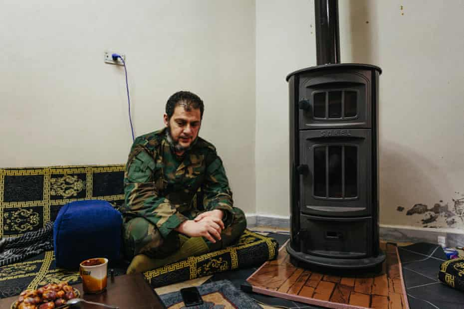Naji Mustafa, a commander with the Northern Front, sits in a temporary HQ in Fuar.