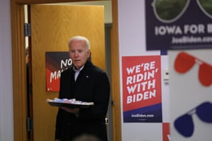 Joe Biden greets volunteers at state campaign headquarters in Des Moines, Iowa, on 13 January.