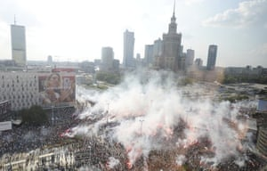 Warsaw, Poland Residents stand with national flags and flares