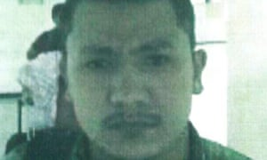 Thai police issued a photograph of Izan and called him a member of the Uighur ethnic minority in China.