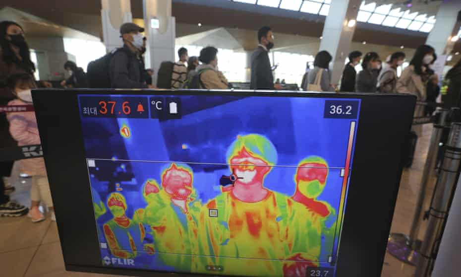A thermal camera monitor shows the body temperature of passengers in Seoul, South Korea