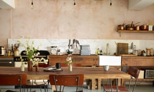 Table talk: the kitchen with freestanding appliances and a table top made of a single piece of redwood.