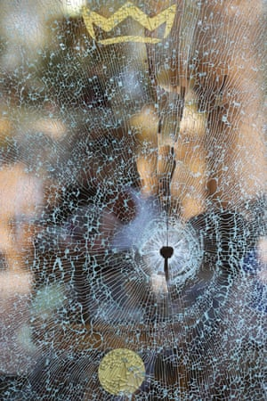 A window shattered by a bullet bears the crest of the Imperial Marhaba Hotel.