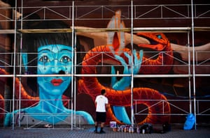 Pristina, Kosovo A Mexican artist works on his creation during the Meeting of Styles graffiti festival