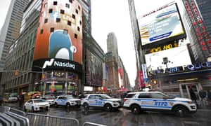 A row of New York City police cars parked along a street in Times Square ahead of New Year's Eve.