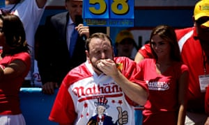 Competitive eater Joey Chestnut holds the current world record of 75 hotdogs in 10 minutes.