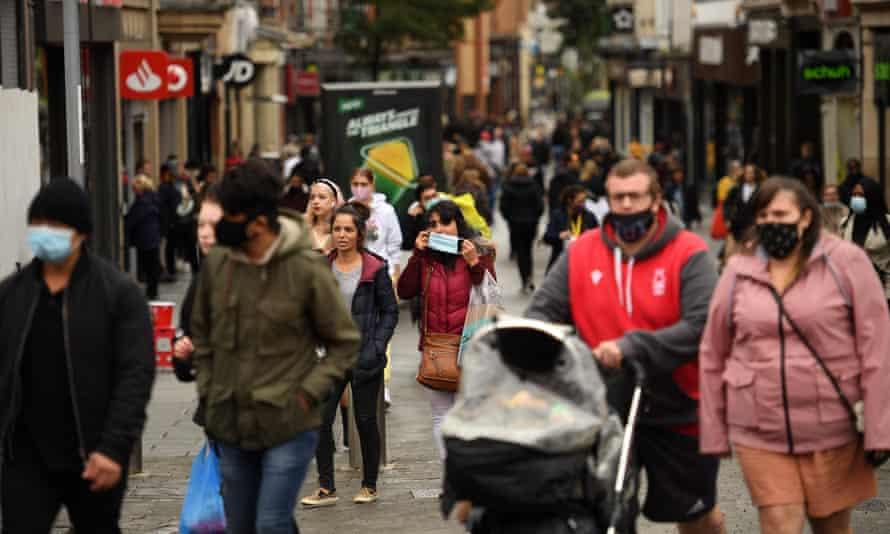 Pedestrians wearing face masks walk through central Nottingham