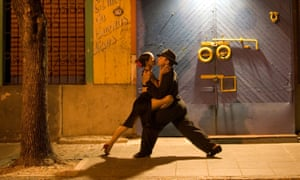 a couple perform the tango