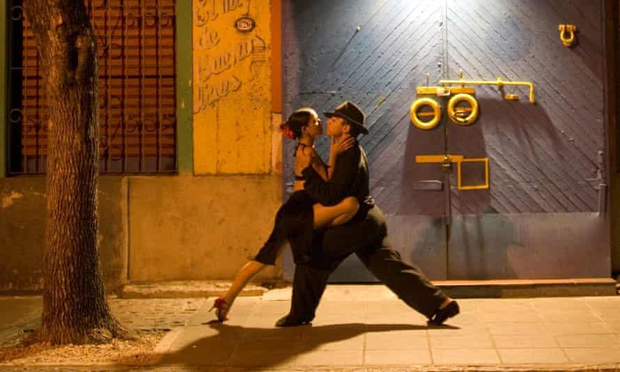 a couple perform the tango