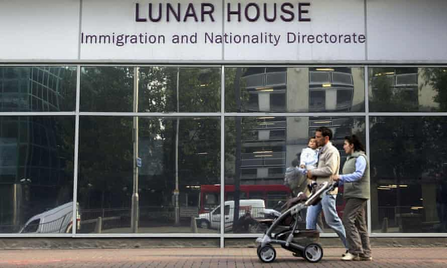 Family outside headquarters of UK Visas and Immigration in London
