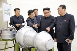Kim Jong-un meets nuclear weapons scientists including Hong Sung-mu (right) and Ri Hong-sop (second left).