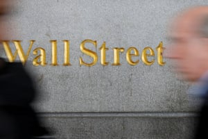 A Wall Street sign close to the New York Stock Exchange .