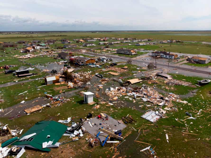 This aerial view shows damage to a neighborhood by Hurricane Laura outside of Lake Charles, Louisiana.