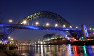 The Tyne Bridge, linking Newcastle upon Tyne and Gateshead in north-east England, is illuminated in blue