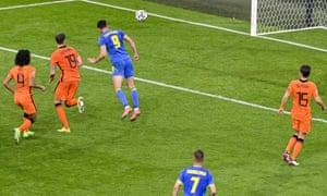 Ukraine's Roman Yaremchuk heads the ball to score their equaliser.