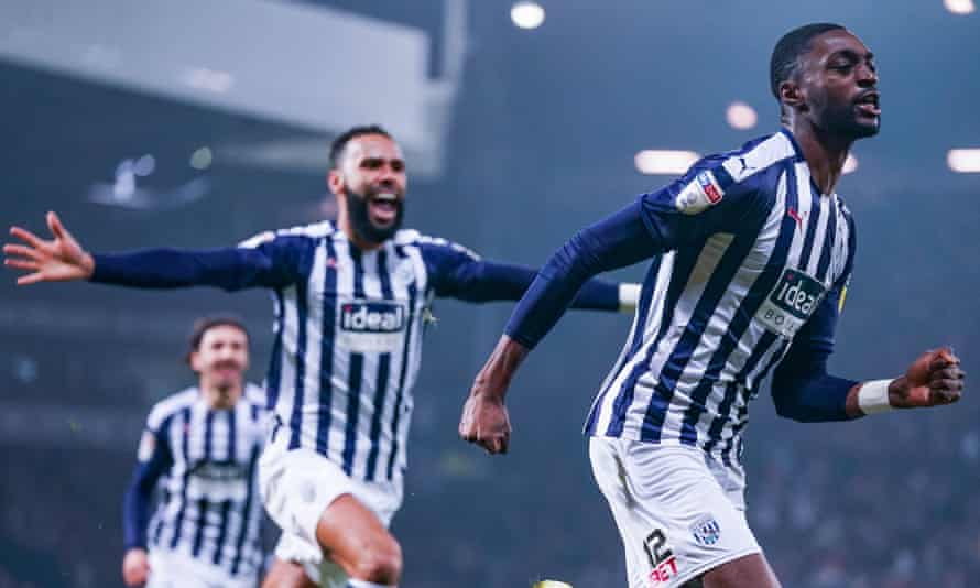 Teammates rush to congratulate Semi Ajayi on giving West Brom a second-minute lead against Leeds