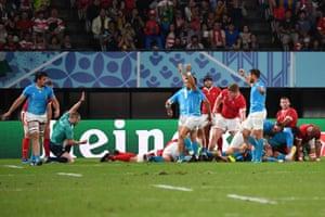 Uruguay's players celebrate after hooker German Kessler scored a try.