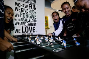 Members of the Philippines team play table football in Manila