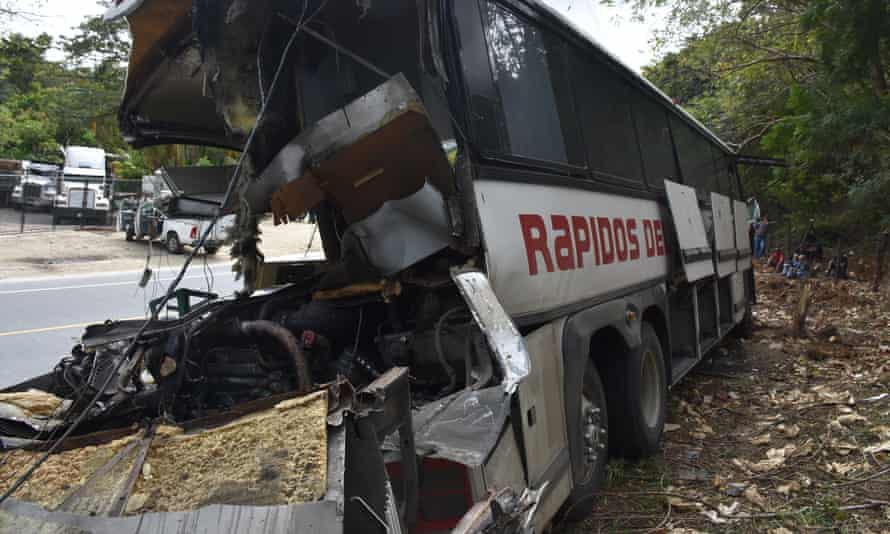 The wreckage of a passenger bus that crashed with a trailer truck near Gualan, Guatemala