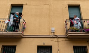 Neighbours chat on their balconies in Spain.