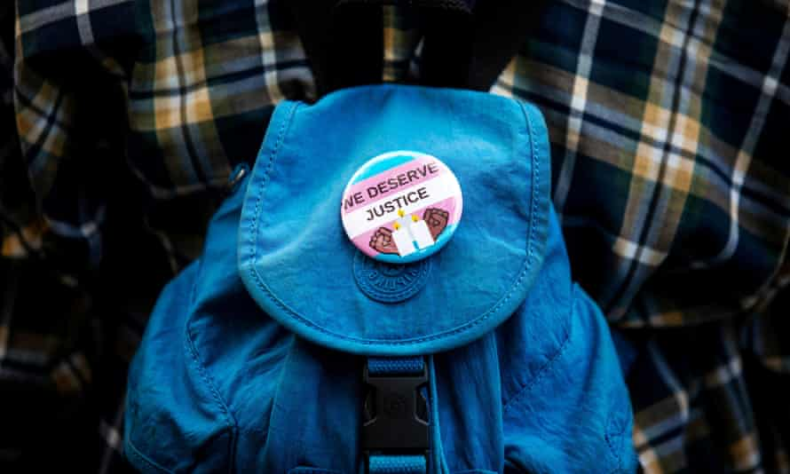 A 'We Deserve Justice' button is seen as people New York protest the killings of three trans women – Muhlaysia Booker, Claire Legato and Michelle Washington – in 2019.