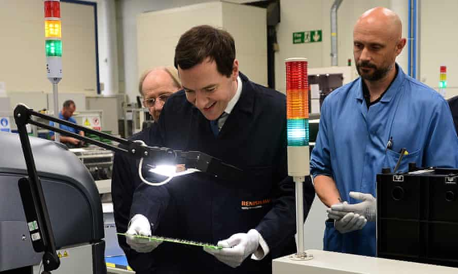 Chancellor George Osborne inspects a printed circuit board during a visit to Renshaw in Woodchester near Stroud, Gloucestershire