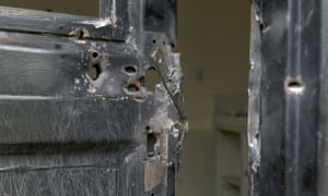 Bullet holes in a metal door that was shot open at the Terrain hotel compound in Juba, South Sudan.