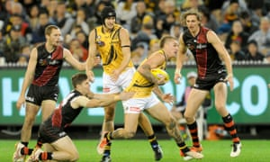 Dustin Martin breaks free of a tackle for the Tigers.