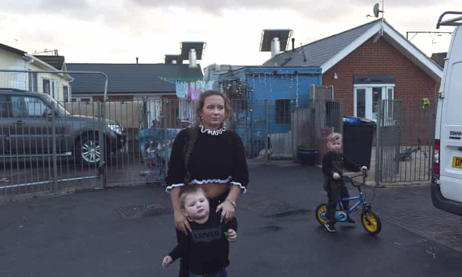 Angela Mahoney plays with her young nephew and cousin at the Eleanor St Travellers' site in Tower Hamlets, east London.