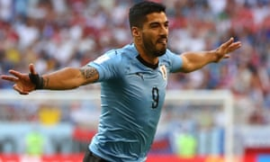 Luis Suárez celebrates putting Uruguay 1-0 up against Russia in their World Cup Group A match.