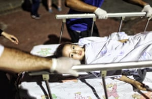 A wounded girl is wheeled into Bakirkoy Sadi Konuk Hospital following the terror attack on Ataturk Airport in Istanbul.