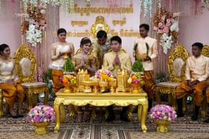 Phnom Penh, Cambodia: Leang Phannara and Kim Bethyliza during their traditional Khmer wedding ceremony, which was delayed for months by coronavirus restrictions
