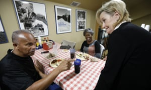 Senator Cindy Hyde-Smith, right, speaks with James Ball, left, and Sallie Vaughn as she campaigns in Madison, Mississippi.