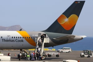 Passengers board a Thomas Cook airplane at the Heraklion airport. Thousands of holidaymakers are being flown back home after the company's collapse