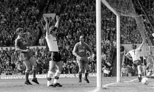 Bryan Robson celebrates after scoring past Liverpool keeper Bruce Grobbelaar at Anfield.