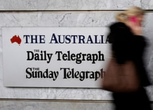 A News Corp employee walks into the company's Holt Street headquarters in Sydney