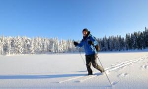 Kevin Rushby crossing a frozen lake near Kobberhaughytta, Norway
