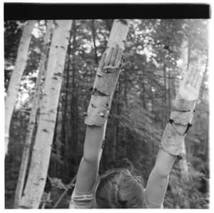 A girl becoming a tree … Francesca Woodman's upraised arms in birch-bark gauntlets.