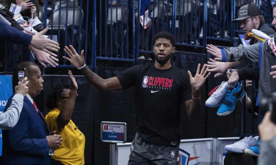 Los Angeles Clippers forward Paul George high-fives fans