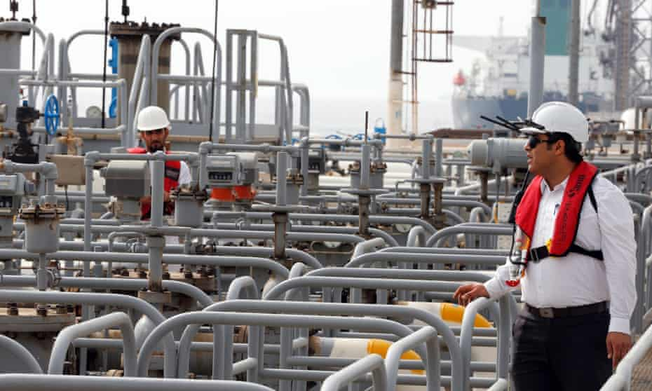Iranian technicians work at the Kharg oil terminal at the Kharg Island, southern Iran. The US government has announced it will reimpose sanctions that had been waived under the Iran nuclear deal.
