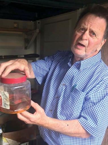 Edwin Hardeman with a jar of Roundup.