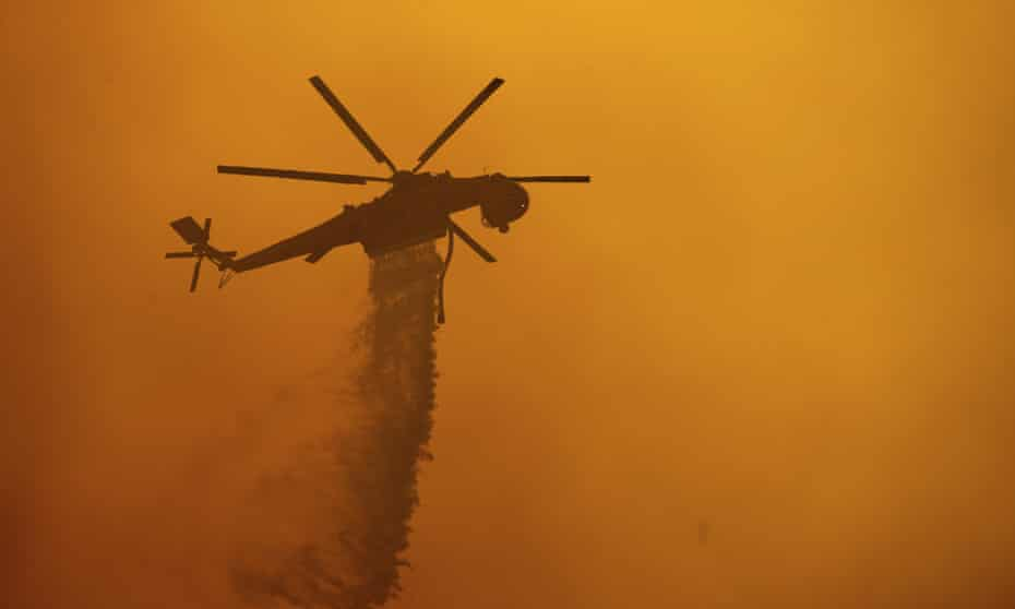 Firefighters battle the Fawn fire burning north of Redding in Shasta county on Thursday.