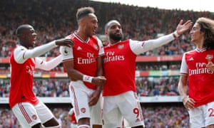 Arsenal's Pierre-Emerick Aubameyang celebrates with teammates after scoring their second goal.