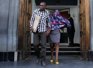 Nairobi, Kenya A police officer escorts a suspect