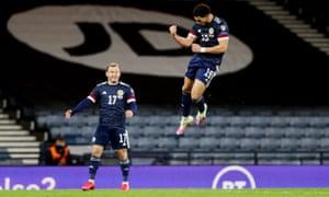 Scotland's Che Adams celebrates scoring their third goal.