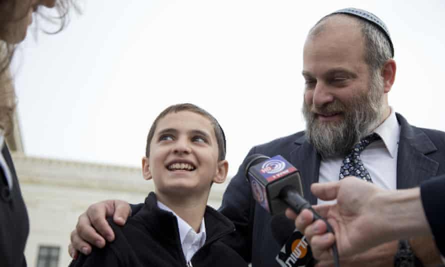 Menachem Zivotofsky and his father, Ari Zivotofsky, speak to media outside the Supreme Court in Washington on 3 November 2014.