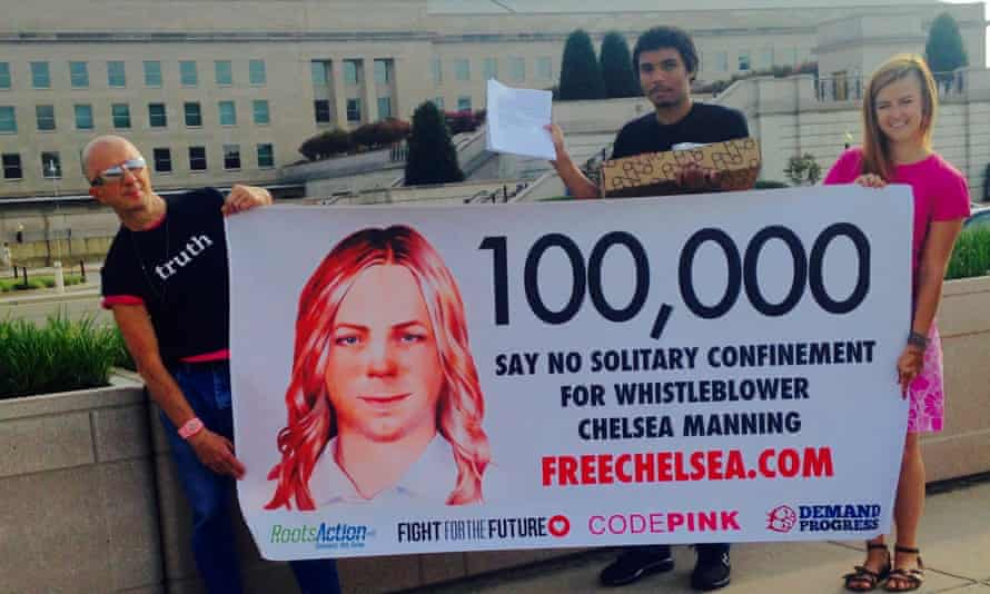18 August 2015 Chelsea Manning supporters hold up banners near the Pentagon before delivering more than 100,000 signatures to the U.S. Army calling for new charges against whistleblower Chelsea Manning to be dropped.