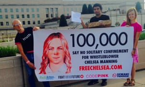 Chelsea Manning supporters hold up banners near the Pentagon in 2015 before delivering more than 100,000 signatures to the US army calling for new charges against whistleblower to be dropped.