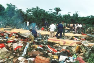 Helpers search through the wreckage of the SLM-DC8 in the days following the accident.