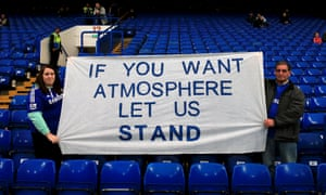 Chelsea fans hold up a banner in favour of standing at football matches